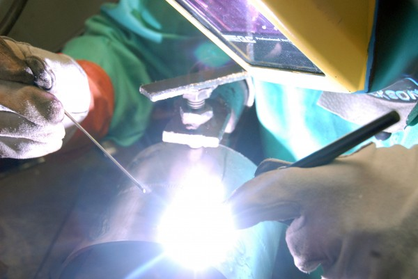 Bradley Cowan, a maintenance worker at Lincoln Paper & Tissue LLC., practices tungsten inert gas welding at Northern Penobscot Tech-Region III on Monday, Dec. 3, 2012.