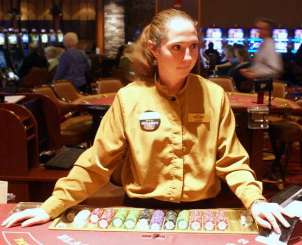 Amber Carter of Norway, a dealer at the Oxford Casino, waits for a player Monday. Carter is one of about 420 full-time employees, according to casino spokesman Scott Smith, who said there are about 440 total full-time positions at the casino.
