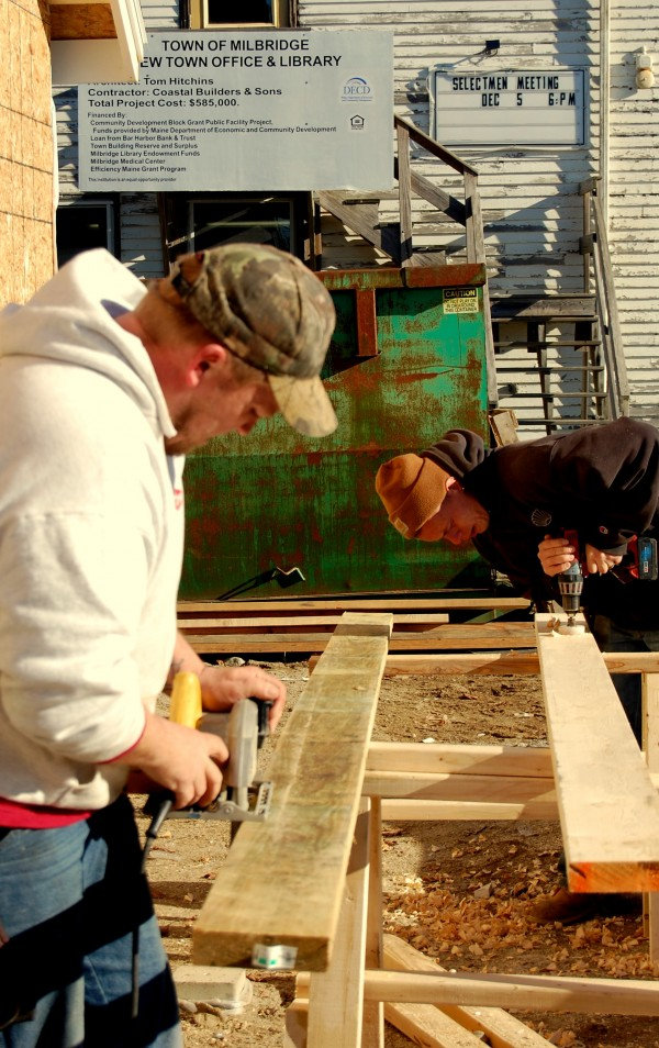 This week's stretch of fair weather had Coastal Builders carpenters Shawn Beers (left) and Paul Cote working on building interior walls Wednesday morning for the new Milbridge town office and library.