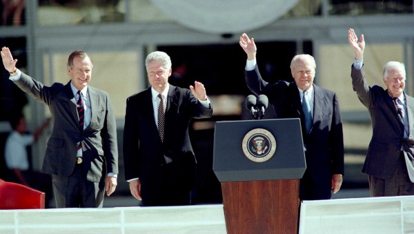 Four U.S. Presidents George Bush, Bill Clinton, Gerald Ford and Jimmy Carter wave to the crowd at Texas A&M University for the dedication of the George Bush Presidential Library and Museum on November 5, 1997 in College Station, Texas.