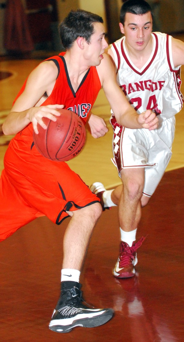 Brewer's Jeff Weeks (lest) tries to drive past Bangor's Matt Cosgrove during fourth-quarter action at Bangor High School on Friday. Bangor won 57-49.