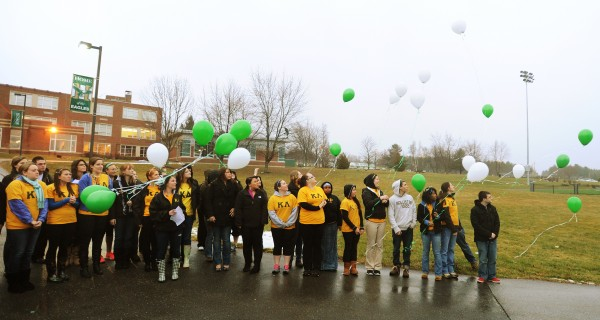 Husson University students, many of them Kappa Delta Phi members, let go balloons carrying prayers at the university on Tuesday, Dec. 18, 2012. The event was to remember the victims of the school shooting in Newtown, Conn., on Friday.