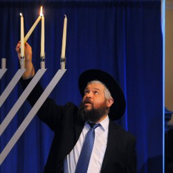 Rabbi lights menorah during ceremony at Bangor Mall