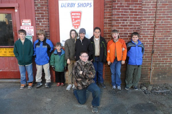 Courtesy photo  MILO, Maine -- Boy Scouts from Brewer's Troop 1 recently toured the Derby Shops of the Montreal, Maine, and Atlantic Railway in Milo as part of their work in achieving the railroading merit badge.  The boys viewed a number of areas of work performed by employees there including locomotive and railcar repair, and inspection and rebuilding of locomotives for their own railroad, and other rail lines. The Scouts also learned more about the railroad which operates in Maine, Quebec and Vermont.  The trip to the Derby Shops was just one part of earning their merit badge. Under the guidance of merit badge counselor Fred Hirsch, they also researched other rail lines, learned about safety around rails, describeed different types of railcars, and identified the numerous types of jobs to run a railroad.  Troop 1 Boy Scouts are(from left) Daniel Loftin, Ethan Anderson, Cub Scout Nathan Page, Samuel Page, Jamie Seymour, Gary Cruzperez, Nicholas Luce, Spencer Proctor, and (kneeling) Jayden Edwards.