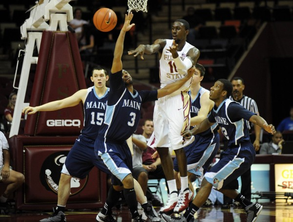Florida State's Okaro White (10) passes the ball while defended by Maine's Jon Mesghna (left) and Xavier Pollard (right) during Florida State's win Sunday in Tallahassee, Fla. Mesghna, a junior transfer, has garnered a starting role for Maine by providing a much-needed 3-point shooting presence.