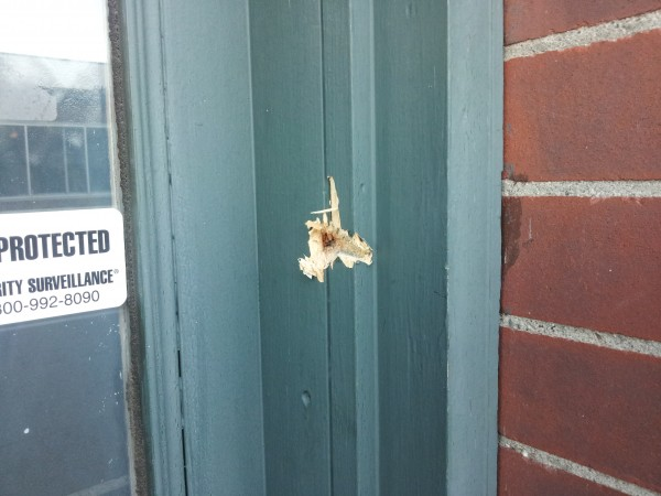 Bullet damage is seen at IBEW Local 1253 union hall building in Fairfield.