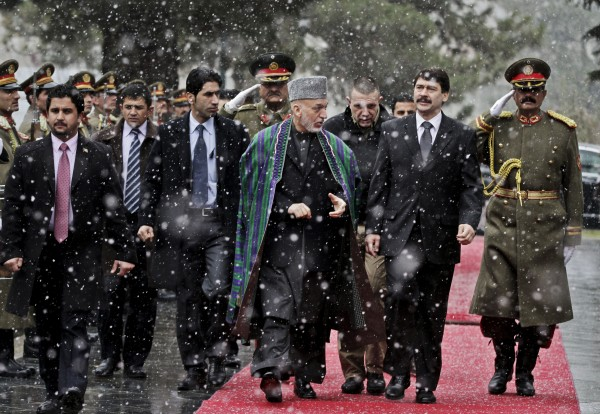 Hungarian President Janos Ader, second right, looks at guards of honor with Afghan President Hamid Karzai after his arrival at the presidential palace in Kabul, Afghanistan, Monday, Dec. 17, 2012. Ader is on an official visiting to Afghanistan.