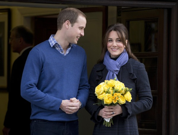 Britain's Prince William stand next to his wife Kate, Duchess of Cambridge, as she leaves the King Edward VII hospital in central London, on Thursday, Dec. 6. Prince William and Kate are expecting their first child, and the Duchess of Cambridge was admitted to hospital suffering from a severe form of morning sickness in the early stages of her pregnancy.