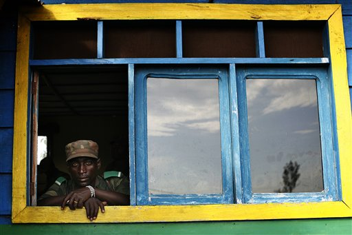 A Congolese FARDC government soldier looks out of the window of  the clubhouse of the base, after they arrived in Goma, eastern Congo Monday, Dec. 3, 2012. Several hundred Congo army soldiers returned to the key eastern city of Goma, as rebels remained poised nearby and a possible fight loomed for the city of 1 million. About 700 government army troops reentered Goma Monday in trucks which arrived at Katindo barracks. Crowds gathered to cheer and sing and some women rushed forward to kiss the troops.