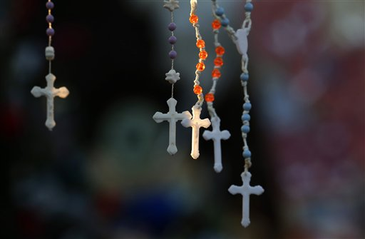 Rosaries are lit by the morning light on a makeshift memorial near the town Christmas tree in the Sandy Hook village of Newtown, Conn., Wednesday, Dec. 19, 2012. The memorial, which was put up in the aftermath of the elementary school shooting that shocked the small town, is increasing in size as the days go on. More funerals are scheduled for Wednesday, as the town continues to mourn its victims. The gunman, Adam Lanza, walked into Sandy Hook Elementary School in Newtown, Conn., on Dec. 14, and opened fire, killing 26 people, including 20 children, before killing himself.