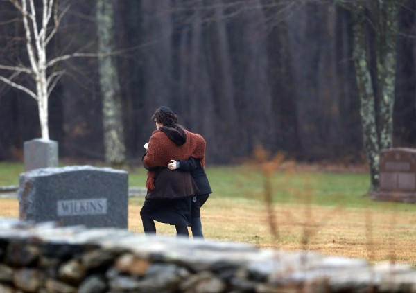 Veronique Pozner, left, embraces a young girl as she arrives at B'nai Israel Cemetery for burial services for her 6-year-old son Noah Pozner, Monday, Dec. 17, 2012, in Monroe, Conn. Noah Pozner was killed when Adam Lanza walked into Sandy Hook Elementary School in Newtown, Conn., Friday and opened fire, killing 26 people, including 20 children, before killing himself.