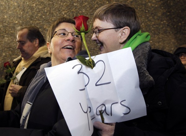 Melody Platt (left) and her partner Beratta Gomillion wait among the first couples in line to be issued a marriage license to a same-sex couple, on Wednesday, Dec. 5, in Seattle. King County Executive Dow Constantine began issuing the licenses just after midnight, Thursday, Dec. 6, immediately upon certification of the November election that passed Referendum 74 allowing same-sex couples to wed. The couple are planning on getting married on their 32nd anniversary, Monday, Dec. 12.