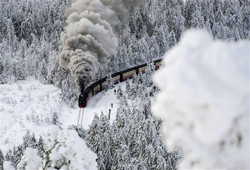 A train on a narrow-gauge railway line makes its way through the winter landscape near Wernigerode, northern Germany on Saturday, Dec. 8, 2012. Parts of Europe were hit hard by heavy snow and freezing temperatures.