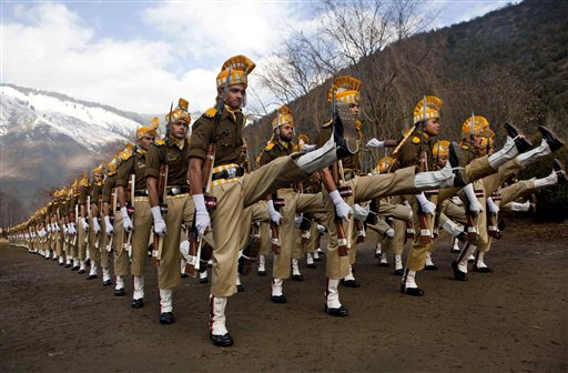 New recruits of the Jammu and Kashmir police participate in a parade in Sheeri, about 37 miles north of Srinagar, India on Wednesday, Dec. 19, 2012. About 900 police officers have completed a nine-month training session in handling nonlethal weapons for controlling street protests in Indian-controlled Kashmir, police said Wednesday.