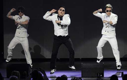 Psy (center) performs during the second night of KIIS FM's Jingle Ball at Nokia Theatre LA Live on Monday, Dec. 3, 2012, in Los Angeles.