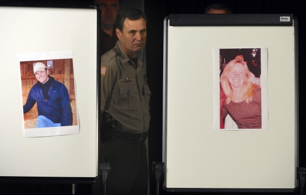 Clackamas County Sherriff Craig Roberts is framed by photos of Clackamas Town Center shooting victims Steven Forsyth, left, and Cindy Yullie, during a news conference Wednesday, Dec. 12, 2012 in Portland, Ore., Wednesday Dec. 12, 2012. The gunman who killed Forsyth, Yullie and himself in a shooting rampage was 22 years old and used a stolen rifle from someone he knew, authorities said Wednesday.