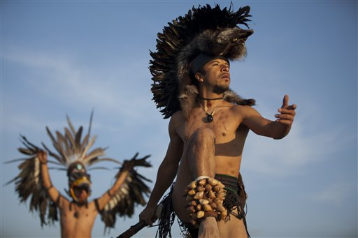 Dancers perform as the sun rises at the Teotihuacan archaeological site in Teotihuacan, Mexico on Friday, Dec. 21, 2012.  Many believe today is the conclusion of a vast, 5,125-year cycle in the Mayan calendar. Some have interpreted the prophetic moment as the end of the world, while others as believed it marked the birth of a new and better age.