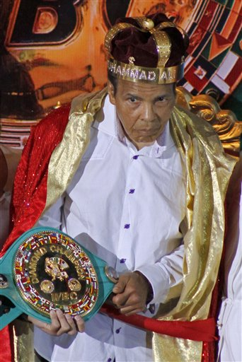 Former world heavyweight champ Muhammad Ali (center) is crowned &quotKing of Boxing&quot during the 50th convention of the World Boxing Council in Cancun, Mexico, Monday, Dec. 3, 2012. The award was given for Ali's lifetime achievements.
