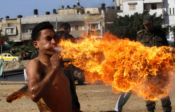 A members of Hamas' Palestinian National Security personnel blows fire during a graduation ceremony in Gaza City, Sunday, Dec. 2, 2012. Israel has rejected the borders of a future Palestinian state the U.N. endorsed last week and on Friday, Israel announced it would press ahead plans to build thousands of settler homes. And it is punishing the Palestinians further by withholding more than $100 million in taxes and other funds collected on their behalf.