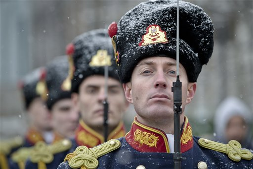 Honor guard soldiers stand during the commemoration of the 1989 anti-communist uprising at the Heroes Cemetery in Bucharest, Romania on Friday, Dec. 21, 2012. The uprising, which left more than 1,000 dead, ended the rule of dictator Nicolae Ceausescu, 23 years ago. Revolution fighters and relatives of the dead ones scuffled briefly with riot police when they tried to prevent the laying of wreaths on behalf of the country's president and government.