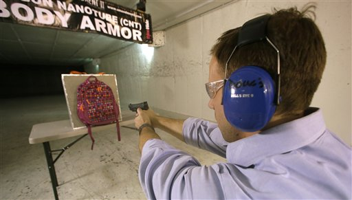 Rick Brand, Chief Operating Officer of Amendment II, shoots a 9 mm pistol into a children's backpack (left) fitted with an anti-ballistic insert, during a demonstration at a gun range on Wednesday in Taylorsville, Utah. Anxious parents reeling in the wake the Connecticut school shooting are fueling sales of armored backpacks for children, as firearms enthusiasts stock up on assault rifles.
