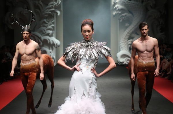 A model showcases a creation by French fashion designer On Aura Tout Vu during the French Couture 2012 Singapore fashion show on Sunday, Dec. 2, 2012, in Singapore.