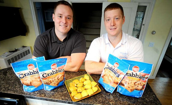 Brothers Scott Demers (left), 29, and Jon Demers, 24, started distributing Crabbies, a frozen appetizer just like their grandmother used to make, in July of this year. The Perfect Party Foods flagship is now available in more than 500 groceries stores.
