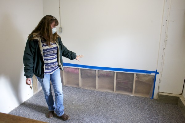 Stetson Deptuty Town Clerk Catherine Fisher shows an area of the Stetson town offices iwhere the drywall was removed because of black mold.