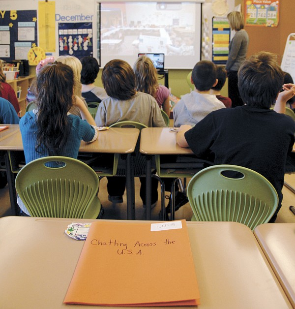 "Brewer Community School third-graders in the classroom of teacher Cherrie MacInnes video-chat with third-graders at a public school in Lake Ariel, Penn. in mid-December. Lying on the desk is a ""Chatting Across the U.S.A."" journal being kept by Luke."
