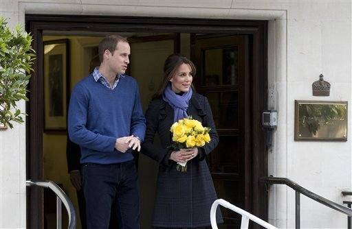 Britain's Prince William stands next to his wife Kate, Duchess of Cambridge as she leaves the King Edward VII hospital in central London, Thursday, Dec. 6, 2012. Prince William and his wife Kate are expecting their first child, and the Duchess of Cambridge was admitted to hospital suffering from a severe form of morning sickness in the early stages of her pregnancy.