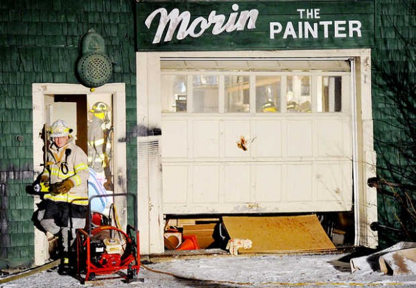 Deputy Chief Geoff Low of the Auburn Fire Department exits the former Morin Fine Furniture and Refinishing shop at 177 Turner St. on Wednesday.