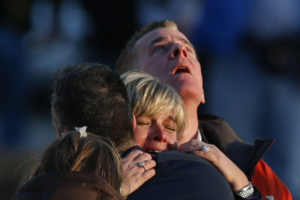 The families of victims grieve near Sandy Hook Elementary School, where a gunman opened fire on school children and staff in Newtown, Conn., on Friday. A heavily armed gunman opened fire on school children and staff at the elementary school, killing at least 27 people, including 20 children.