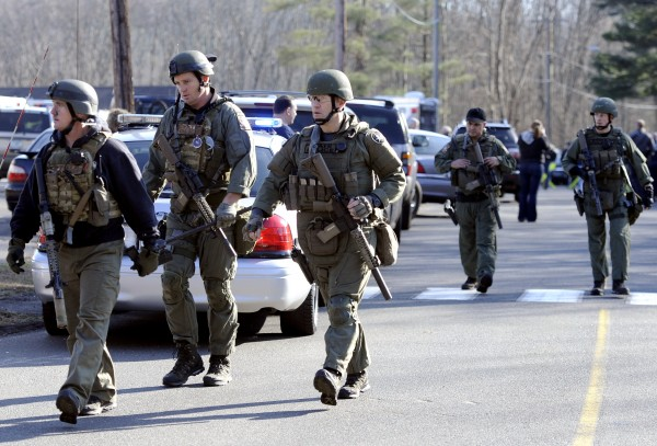 State Police are on scene following a shooting at the Sandy Hook Elementary School in Newtown, Conn., about 60 miles northeast of New York City, Friday, Dec. 14, 2012.