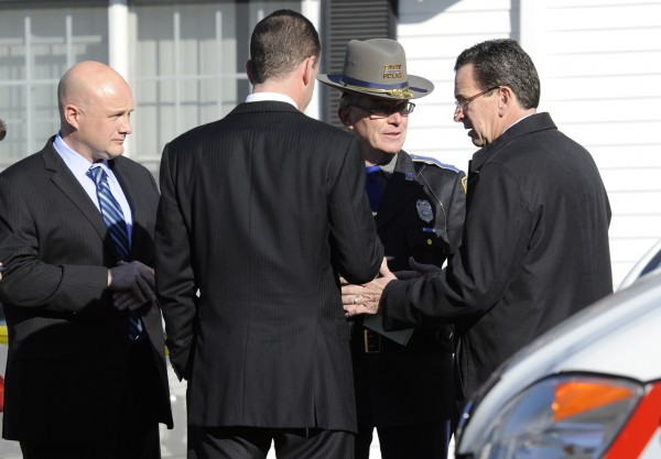 Gov. Dannel P. Malloy, right, talks with officials at a staging area following a shooting at the Sandy Hook Elementary School in Newtown, Conn., about 60 miles  northeast of New York City, Friday, Dec. 14, 2012.
