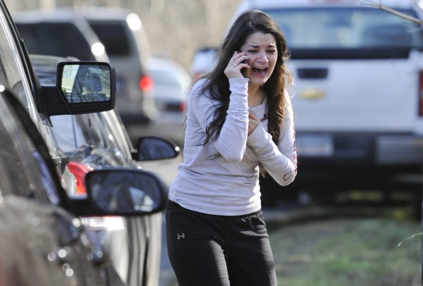 A woman waits to hear about her sister, a teacher, following a shooting at the Sandy Hook Elementary School in Newtown, Conn., about 60 miles northeast of New York City, Friday, Dec. 14, 2012.