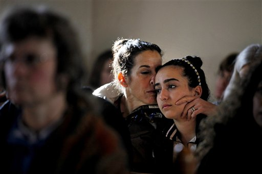 Elizabeth Bogdanoff, left, kisses her daughter Julia, 13, both of Newtown, Conn., during a prayer service at St John's Episcopal Church in Newtown, Saturday, Dec. 15, 2012.