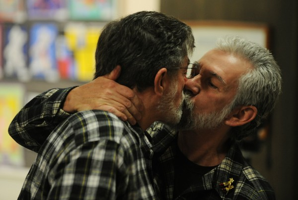 James Beckett and Ken Tidd share a kiss after getting married at Bangor City Hall on Saturday. Beckett and Tidd were the first couple to exchange vows in Bangor after voters approved gay marriage this past November.