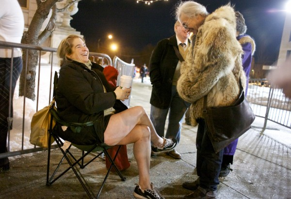 Melanie Lavoie (left) waits in line with her friend Roberta Batt (right) before Batt is wed to her partner of more than 30 years, Mary Donaldson, outside Portland City Hall in Portland.