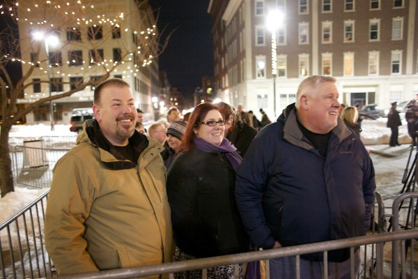 Steven Bridges (from left), Katie Snell and Michael Snell are first in line outside Portland City Hall to be married Friday evening in Portland. Bridges will marry Michael Snell. Katie is Michael's daughter.