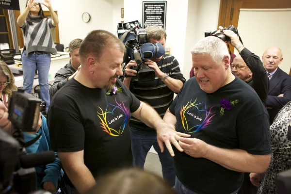 Steven Bridges and Michael Snell exchange rings after getting married at Portland City Hall early Saturday morning in Portland.