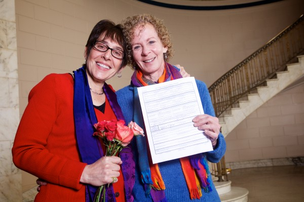 Joan Kunian (left) and Suzanne Blackburn show off their marriage license at Portland City Hall around 1 a.m. Saturday.