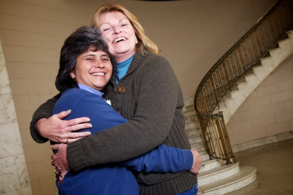 Elizabeth (left) and Cathy LaFerriere embrace in Portland's City Hall in the wee hours of Saturday morning after getting married.