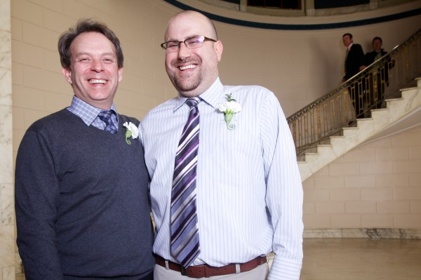 Newlyweds Jeffrey Burdick and Joshua Laton have a laugh in Portland City Hall Saturday morning.