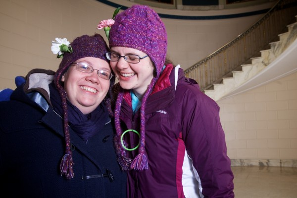 Newlyweds Erica (left) and Alison Lovejoy celebrate in Portland City Hall Saturday morning.