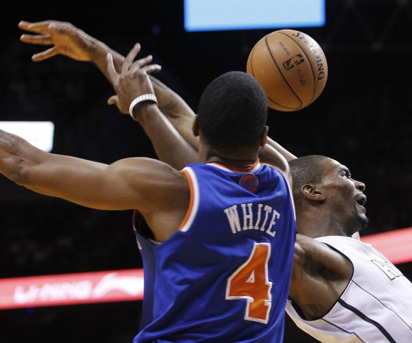 New York Knicks' James White fouls Miami Heat's Chris Bosh in the first half of their NBA basketball game in Miami, Fla. on Thursday.