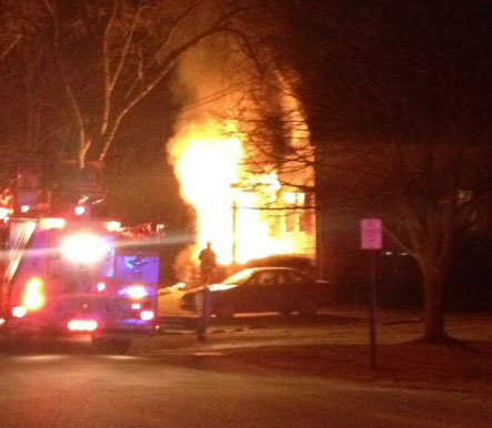 Crews battle a fire on Park Street in South Portland on Wednesday evening, Dec. 12, 2012.