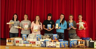 Courtesy photo The Student Council at Dexter Regional High School collected 270 pounds of pasta along with a $100 cash donation for the Dexter Food Closet.  This has been an annual event for the last six years.  The class that donates the most pasta starts off the Winter Carnival with 25 points.  The class of 2015 won the event this year. Taking part in the pasta drive are (from left) Abbey Jordan, Alexandra Cooper, Sarah Eastman, Adam Malinauskas, Dana Webber, Meredith Roderka and Lauren Crane.