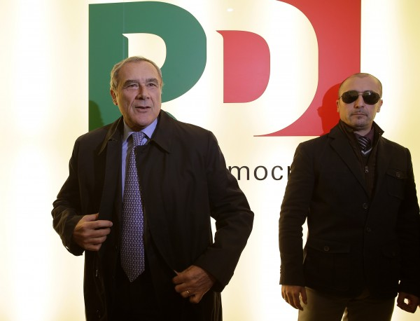 Italian anti-mafia prosecutor Piero Grasso (L) arrives to attend a news conference to present his candidacy with the Democratic Party (PD) ahead of the general election in February 2013, in Rome December 28, 2012.