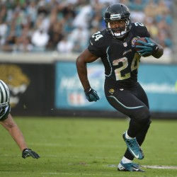 Jacksonville Jaguars fullback Montell Owens (24) runs past New York Jets free safety Eric Smith, left, for a 32-yard touchdown during the second half of an NFL  game, Sunday, Dec. 9, 2012, in Jacksonville, Fla. Owens is a former University of Maine football standout.