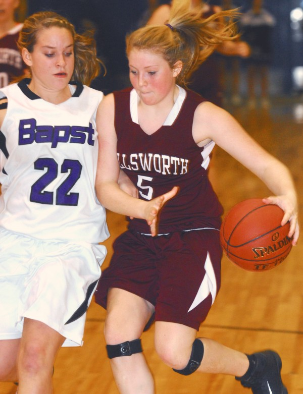Ellsworth's Maddie Card drives to the basket against John Bapst's Courtney Benson (22) in third-quarter action at the Bangor Auditorium Friday night Dec. 14, 2012.